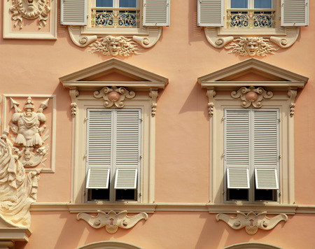 stucco house: Beautiful ornate stucco house with old french grey shutter windows in Principality of Monaco, Monte Carlo.
