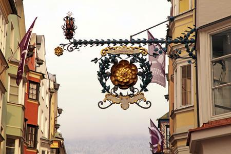 bayern old town: INNSBRUCK, AUSTRIA - FEBRUARY 5, 2015: Medieval historic cafe sign in Innsbruk, Austria Editorial