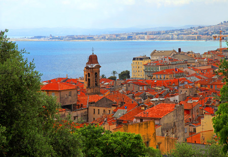 cote d'azur: Beautiful cityscape of Nice with old red roofs and blue sea, French Riviera, Cote dAzur, France. Stock Photo