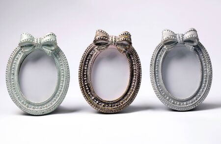 antiquary: Tree ornate vintage oval shape picture frames on white background Stock Photo