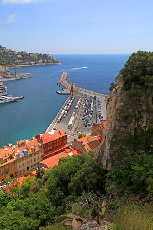 cote d'azur: Vertical view of Nice (Cote dAzur, France) with rock hills, harbor and lighthouse. View from above
