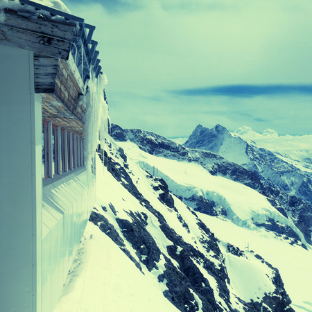monch: Jungfraujoch - Top of Europe is the high point in Swiss Alps. The highest railway station in Europe is located 3,454 meters above sea level. Square toned image