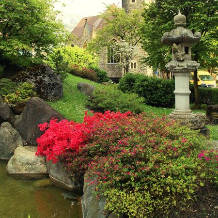 interlaken: A beautiful church and japanese garden in Interlaken, Switzerland. Square toned image