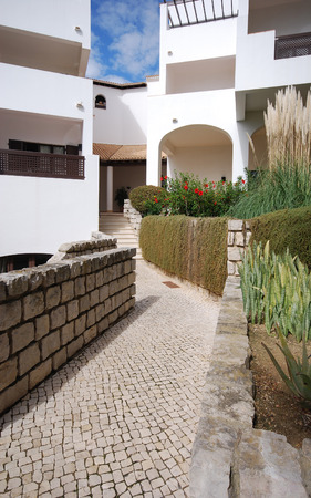holiday villa: Detail of white holiday villa and stone path in summer Algarve Portugal.