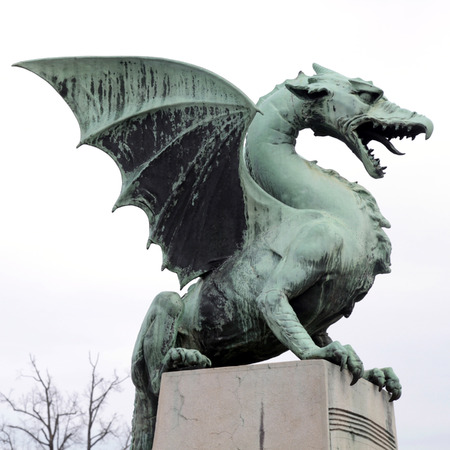 statue: Famous Dragon statue on Dragon bridge Zmajski most symbol of Ljubljana capital of Slovenia Europe. Editorial