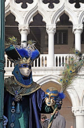 piazza san marco: VENICE, ITALY - FEBRUARY 8, 2015: Costumed people in Venetian mask on the Piazza San Marco during Venice Carnival in Venice, Italy. Editorial