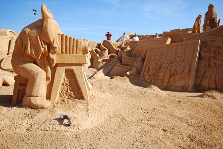 ALGARVE, PORTUGAL - OCTOBER 3, 2009: Photographer large sand sculpture of unidentified artist at FIESA, International Sand Sculpture Festival in Algarve, Portugal. Editorial