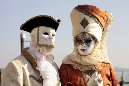 mardigras: VENICE, ITALY - FEBRUARY 8, 2015: Unidentified persons in Venetian mask and romantic costumes at St. Marco Square, Carnival of Venice, Italy
