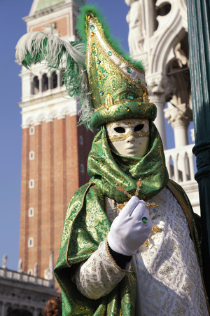 piazza san marco: VENICE, ITALY - FEBRUARY 8, 2015:  Costumed people in Venetian mask on the Piazza San Marco during Venice Carnival in Venice, Italy.