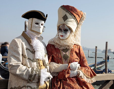 mardigras: VENICE ITALY  FEBRUARY 8 2015: Unidentified persons in Venetian mask and romantic costumes at St. Marco Square Carnival of Venice Italy