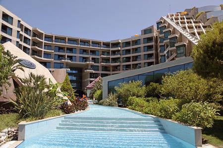 hotel resort: BELEK TURKEY  JUNE 14 2015: Summer view of SuSeSi Luxury Resort Hotel with tourists in swimming pool in Belek Turkey.