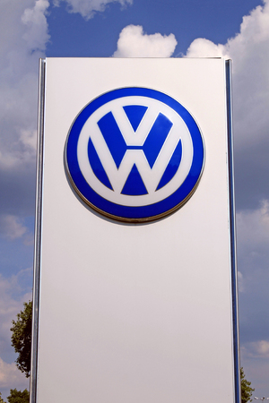 automaker: KIEV UKRAINE  JUNE 25 2015: VW dealership logo stand in Kiev Ukraine. Volkswagen is a German automobile manufacturer and the biggest German automaker and the third largest automaker in the world.