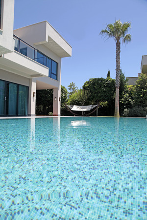 house facades: Swimming pool at the modern luxury villa, Turkey, vertical image Editorial