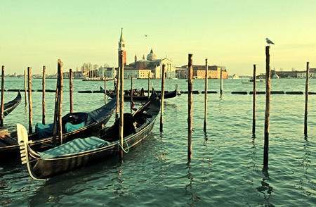 saint mark square: VENICE, ITALY - FEBRUARY 7, 2015: Gondolas moored by Saint Mark square with San Giorgio di Maggiore church in the background ,Venice, Italy. Vintage toned image