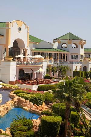 sharm el sheikh: SHARM EL SHEIKH, EGYPT - MAY 03, 2014: Tropical luxury resort hotel on Red Sea beach in Sharm el Sheikh, Egypt. Vertical image