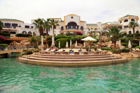 el sheikh: SHARM EL SHEIKH, EGYPT - MAY 06, 2014: Beautiful view with swimming pool and tropical luxury resort hotel on Red Sea beach in Sharm el Sheikh, Egypt.