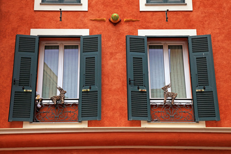 stucco house: Beautiful red stucco house with old french green shutter windows, Monaco, Monte Carlo.