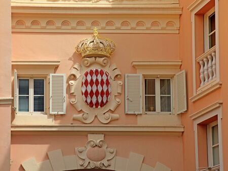 house coat: Architectural detail with Monaco coat of arms - Royal Arms of Prince Albert II, monarch and head of Princely House of Grimaldi, Monaco Stock Photo