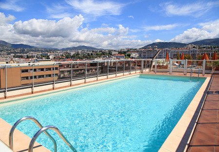 nice: swimming pool on the roof of resort with urban view, Nice, France