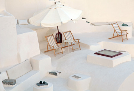 loungers: White traditional terrace with deck chairs in caldera house, Santorini island, Greece Stock Photo