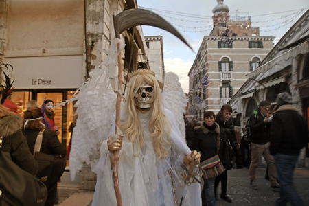 rialto bridge: VENICE, ITALY - FEBRUARY 8, 2015:  Death carnival costume at the Rialto bridge, Venice Carnival in Venice, Italy Editorial