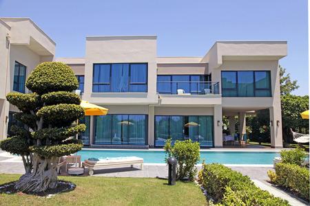 garden lawn: BELEK, TURKEY - JUNE 14, 2015: Swimming pool and modern luxury holiday villa, Belek, Turkey Editorial
