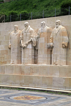 reformation: Reformation wall in Parc Des Bastions, Geneva, Switzerland. Sculptures of the four great figures of the geneva protestant movement : Guillaume Farel, Jean Calvin, Theodore de Beze, John Knox. Vertical image Editorial