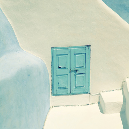 mediterranean house: Detail of the typical blue and white house in Oia, Santorini island, Greece. Square toned image