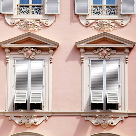 old buildings: Beautiful ornate pink house with old french grey shutter windows in Principality of Monaco, Monte Carlo. Square toned image