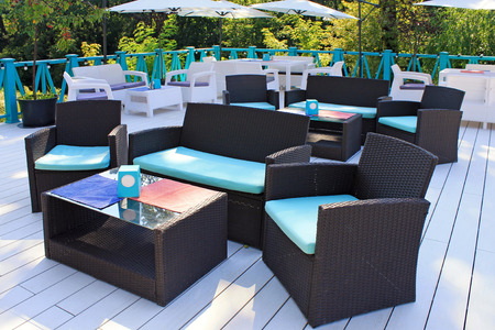 al fresco: Al fresco cafe with rattan wicker armchairs and tables on the summer garden terrace