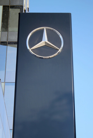 ag: HERZLIYA, ISRAEL - AUGUST 31, 2015: Mercedes-Benz sign pylon in Herzliya, Israel. Mercedes is  German automobile manufacturer, multinational division of German manufacturer Daimler AG. Editorial