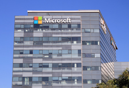 microsoft: HERZLIYA, ISRAEL - AUGUST 31, 2015: Microsoft corporation office building facade with logo in Herzliya, Israel. Microsoft Corporation is an American multinational technology company.