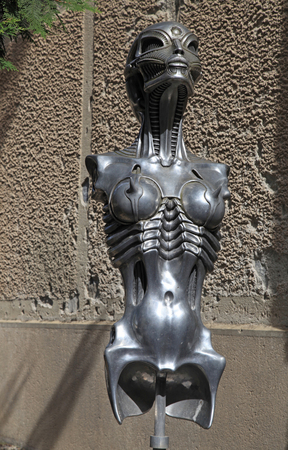 surrealist: GRUYERES, SWITZERLAND - MAY 8, 2013: Surrealist sci-fi women statue in H.R. Giger museum in Gruyeres, Switzerland, Europe.