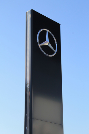 ag: HERZLIYA, ISRAEL - AUGUST 31, 2015: Mercedes-Benz sign against sky in Herzliya, Israel. Mercedes-Benz is a division of Daimler AG, a luxury brand for cars.