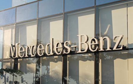 ag: HERZLIYA, ISRAEL - AUGUST 31, 2015: Mercedes-Benz dealership logo in Herzliya, Israel. Mercedes-Benz is a division of Daimler AG, a luxury brand for cars. Editorial