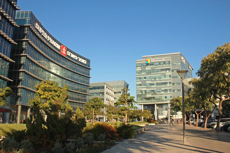 microsoft: HERZLIYA, ISRAEL - AUGUST, 31, 2015: Urban landscape with modern futuristic architecture building, Microsoft and Super-Pharm office, Herzliya, Israel.