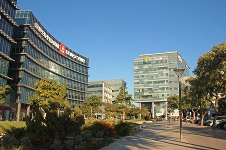 HERZLIYA, ISRAEL - AUGUST, 31, 2015: Urban landscape with modern futuristic architecture building, Microsoft and Super-Pharm office, Herzliya, Israel.