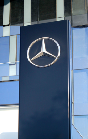 ag: HERZLIYA, ISRAEL - AUGUST 31, 2015: Mercedes-Benz sign pylon in Herzliya, Israel. Mercedes is German automobile manufacturer, multinational division of German manufacturer Daimler AG.