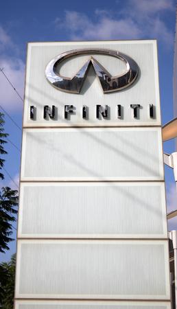 infiniti: HERZLIYA, ISRAEL - AUGUST 31, 2015: Infiniti dealership logo stand in Herzliya, Israel. Editorial