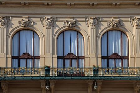 old buildings: beautiful windows with Art Nouveau architecture details of Municipal House in Prague, Czech Republic