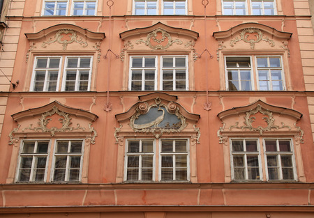 pediment: Classical colorful baroque building with ornate windows and pediment in Prague, Czech Republic Editorial