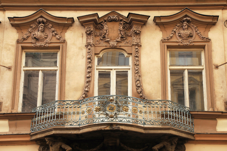 pediment: Classical colorful baroque window with balcony and pediment in Prague, Czech Republic