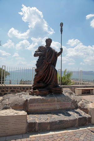 Statue of apostle Saint Peter in biblical Capernaum on the coast of Galilee sea (Kinnereth), Israel. Vertical image