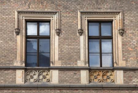 pediment: Classical baroque window with ornate stone pediment in blick wall, Prague, Czech Republic