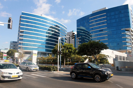 israel people: HERZLIYA, ISRAEL - AUGUST 31, 2015: Streets and modern building in Herzliya, Israel. Herzliya Pituach is a sought-after venue for high-tech companies and one of Israels most affluent neighborhoods. Editorial