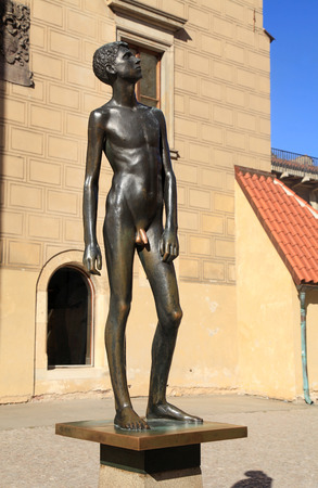 naked statue: PRAGUE, CZECH REPUBLIC - SEPTEMBER 28, 2015: The statue of a naked boy Youth in Prague Castle, Prague, Czech Republic. selective focus Editorial