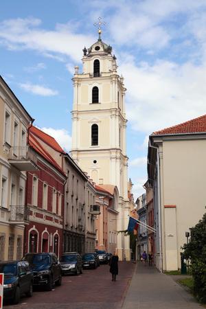vilnius: VILNIUS, LITHUANIA - JULY 20, 2015 : Old Town streets and St Johns Church in Vilnius University, Vilnius, Lithuania.