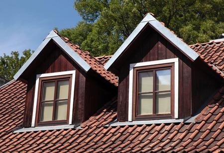 garret: orange tiled roof and garret windows in old house, Vilnius