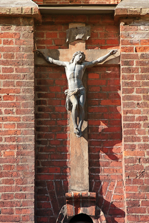 bible altar: Sculpture of the Jesus on the red brick medieval wall of St. Annes Church in Vilnius, Lithuania.