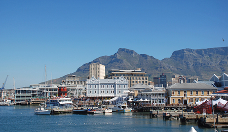 capetown: CAPE TOWN,SOUTH AFRICA-DECEMBER, 30, 2007: Victoria and Alfred Waterfront, harbor with recreation boats, shops, restaurants and Table Mountain on background in Cape Town, South Africa. Editorial